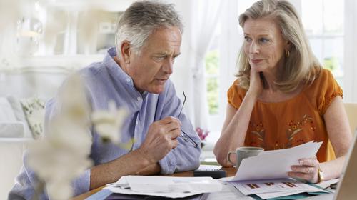 retired couple reviewing documents
